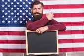 Providing Training Course. Hipster Holding Scissors And Blackboard In Training School. Bearded Man G poster