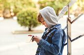 Preteen Boy Playing A Game On The Smartphone Outdoors. Leisure, Children, Technology, Internet Commu poster