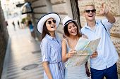 Happy Group Of Tourists Traveling And Sightseeing Together At Summer poster