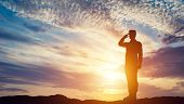 Soldier saluting. Sunset sky, sun shining. Army, salute, patriotic concept. 3D illustration poster