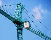Construction Crane. Self-erection Crane Against Blue Sky. Building Crane. poster
