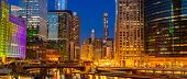 Panorama shot of City of Chicago downtown and Chicago River sunset night Illinois USA. poster
