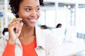 Front view of happy African-american female customer service executive standing with headset standin poster
