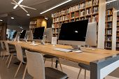 Room With Modern White Computers In A University Or College Library. Computer Class. poster