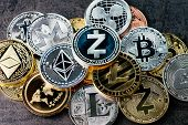 Crypto Currency Background With Various Of Shiny Silver And Golden Physical Cryptocurrencies Symbol  poster