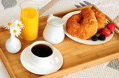 foto of orange-juice  - Tray with breakfast on a hotel room bed - JPG