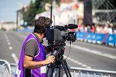 Tv Camera Operator At The Live Event. Television. Telecast. Correspondent. Press poster