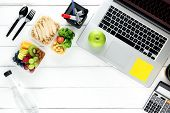 Clean Healthy Ready Ot Eat Low Fat Food In Meal Box Set Prepared For Lunch On Working Table With Lap poster