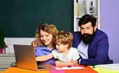 Boy From Elementary School. Mother Father And Son Together Schooling. Back To School And Home School poster