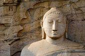 foto of polonnaruwa  - Buddha face with ornamental stone background - JPG