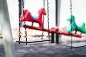 Empty Swing At A Playground. Sad Dramatic Mood For Negative Themes Such As Bullying At School, Child poster