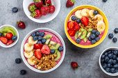 Summer Acai Smoothie Bowls With Strawberries, Banana, Blueberries, Kiwi Fruit And Granola On Gray Co poster