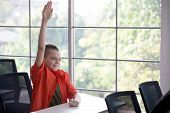 Cute Children Boy Student Raising Hands  In Classroom At School . Genius Kid Hand Up . Great Idea .  poster