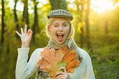 Autumn Woman. Happy Autumn Girl Wink. Cheerful Carefree Autumn Woman In Park On Sunny Day. Girl Play poster