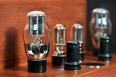 Old-fashioned electronic device amplifier bulb diode lamp for sound reproduction close-up