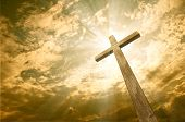 stock photo of crucifixion  - Wooden cross against the sky with shining rays - JPG