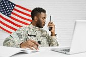 Worker Of American Army Writing Documents, Using Laptop And Destination Radio Remote, Talking With C poster
