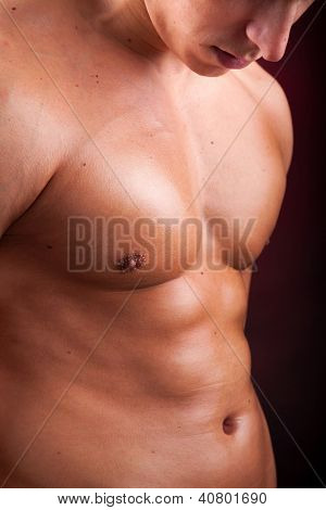 Image of a handsome athletic man on black background
