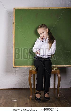 schoolgirl with chalkboard in studio