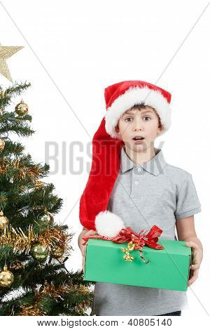 Happy Boy In Santa Hat Surprised By Christmas Present