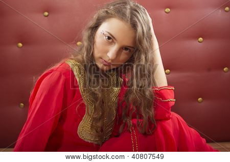 girl sitting in orient costume
