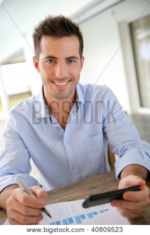 Man working from home on smartphone