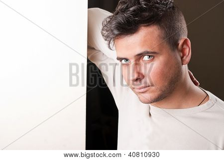 Man Leaning Against The Wall