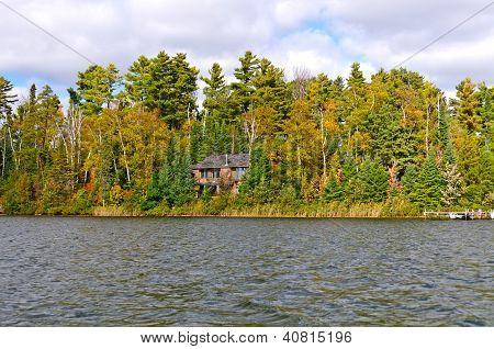 House On A Remote Lake In The Fall