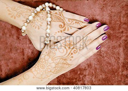 Henna art on woman's hand
