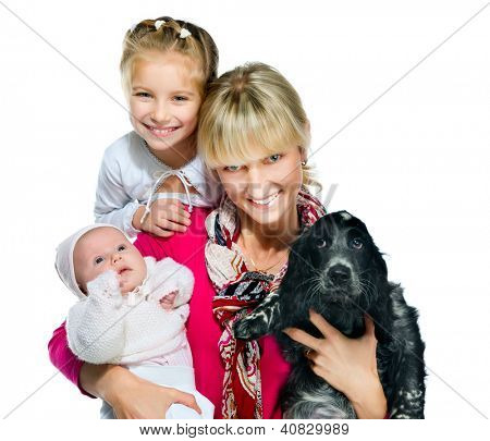 young woman with her daughters and dog on a white background
