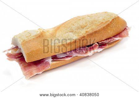 closeup of a spanish serrano ham sandwich on a white background