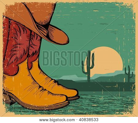 Western Background With Cowboy Shoes And Desert Landscape On Old Paper
