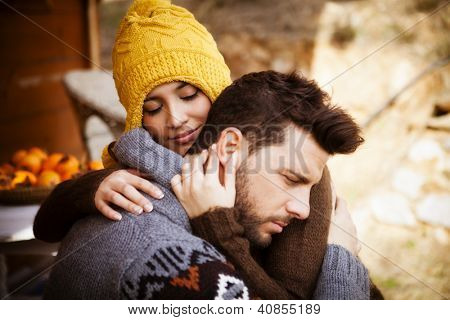 Portrait of a couple, she embrase him with eyes closed