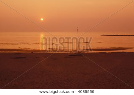 Sunrise On A Desert Beach