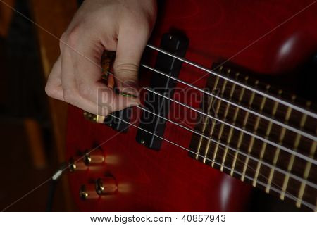 Playing on red guitar