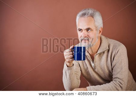 Smiling senior with a cup
