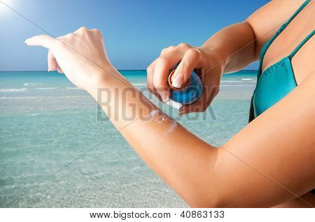 Woman Applying Sunscreen