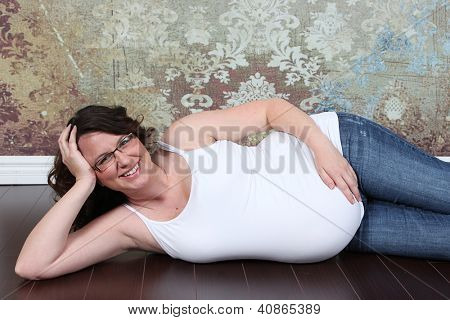 Beautiful pregnant woman 8 months along in studio