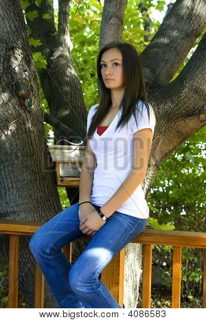 Teenager Girl Posing In The Backyard