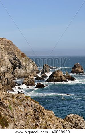 Vertical rocky shoreline near Bodega Bay on the California coast