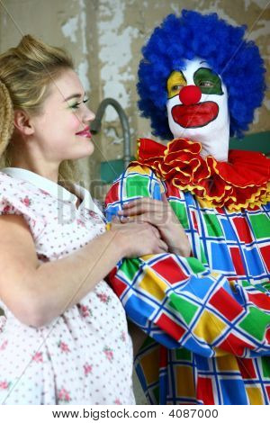 Clown Starring At A Beautiful Girl