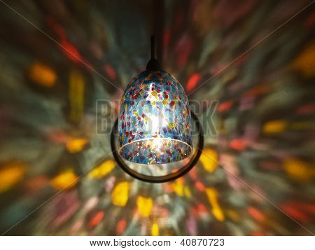 Lamp Lights In A Rainbow Sconce On A Wall