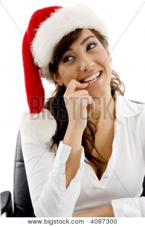 Front View Of Shy Female Executive Wearing Christmas Hat Looking Sideways