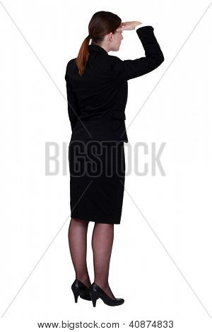 businesswoman seen from behind looking in the distance