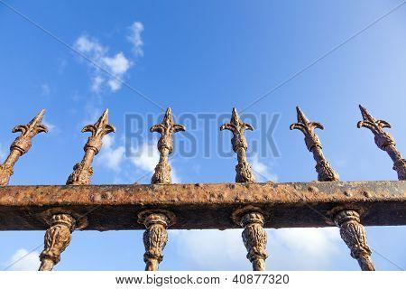 Rusty Fence Under Blue Sky