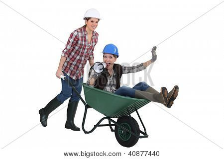 Woman being pushed around in wheelbarrow