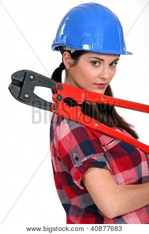 Female construction worker holding a pair of heavy-duty clippers