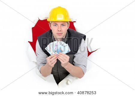craftsman holding money
