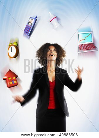 Happy female executive juggling responsibilities over colored background