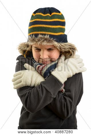 Little child wearing beanie trying to warm up